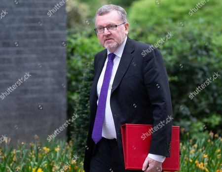 David Mundell, Secretary of State for Scotland, arrives for the Cabinet meeting.