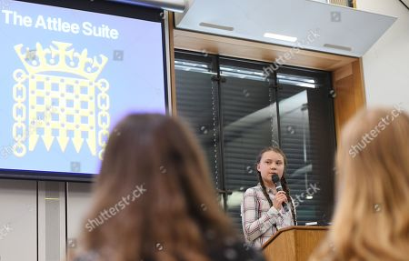 Swedish schoolgirl climate activist Greta Thunberg speaks during an event inside the Houses of Parliament in Westminster, London, Britain, 23 April 2019. Greta Thunberg, was joined by Green Leader Caroline Lucas, Former Labour leader, Ed Miliband and Secretary of State for the Environment, Michael Gove. Her visit coincides with the ongoing 'Extinction Rebellion' protests across London aimed to highlight the dangers of climate change.