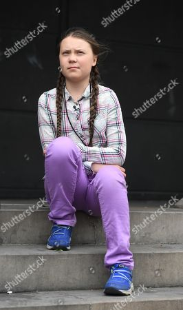 Swedish schoolgirl climate activist Greta Thunberg sits for a television interview outside the Houses of Parliament in Westminster, London, Britain, 23 April 2019. Greta Thunberg, was joined by Green Leader Caroline Lucas, Former Labour leader, Ed Miliband and Secretary of State for the Environment, Michael Gove. Her visit coincides with the ongoing 'Extinction Rebellion' protests across London aimed to highlight the dangers of climate change.