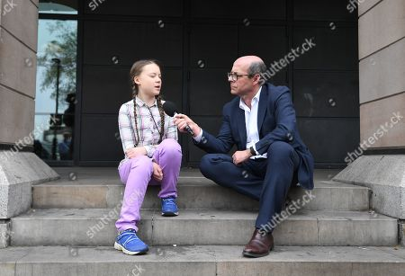 Swedish schoolgirl climate activist Greta Thunberg (L) speaks to BBC television journalist, Nick Robinson (R) outside the Houses of Parliament in Westminster, London, Britain, 23 April 2019. Greta Thunberg, was joined by Green Leader Caroline Lucas, Former Labour leader, Ed Miliband and Secretary of State for the Environment, Michael Gove. Her visit coincides with the ongoing 'Extinction Rebellion' protests across London aimed to highlight the dangers of climate change.