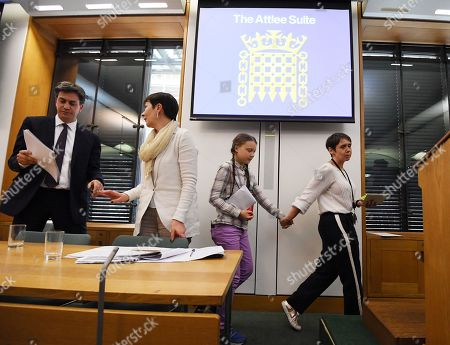 Swedish schoolgirl climate activist Greta Thunberg (2-R) leaves behind former Labour leader, Ed Miliband (L) and Green Leader Member of Parliament Caroline Lucas (2-L) during an event inside the Houses of Parliament in Westminster, London, Britain, 23 April 2019. Greta Thunberg, was joined by Green Leader Caroline Lucas, Former Labour leader, Ed Miliband and Secretary of State for the Environment, Michael Gove. Her visit coincides with the ongoing 'Extinction Rebellion' protests across London aimed to highlight the dangers of climate change.
