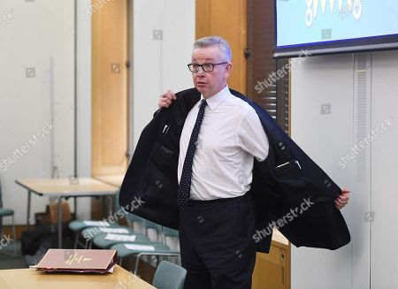 Secretary of State for the Environment, Michael Gove arrives to speak in a panel with Swedish schoolgirl climate activist Greta Thunberg during an event inside the Houses of Parliament in Westminster, London, Britain, 23 April 2019. Greta Thunberg, was joined by Green Leader Caroline Lucas, Former Labour leader, Ed Miliband and Secretary of State for the Environment, Michael Gove. Her visit coincides with the ongoing 'Extinction Rebellion' protests across London aimed to highlight the dangers of climate change.