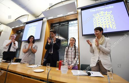 Swedish schoolgirl climate activist Greta Thunberg (2-R) is applauded by former Labour leader, Ed Miliband (C) and Green party Leader and Member of Parliament Caroline Lucas (R) Secretary of State for the Environment, Michael Gove (L) during an event inside the Houses of Parliament in Westminster, London, Britain, 23 April 2019. Greta Thunberg, was joined by Green Leader Caroline Lucas, Former Labour leader, Ed Miliband and Secretary of State for the Environment, Michael Gove. Her visit coincides with the ongoing 'Extinction Rebellion' protests across London aimed to highlight the dangers of climate change.