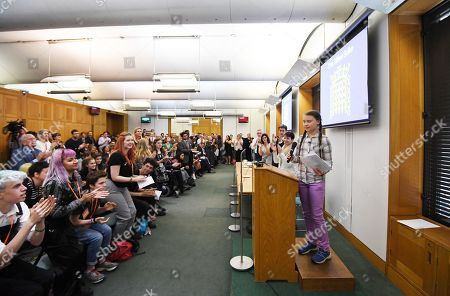 Swedish schoolgirl climate activist Greta Thunberg (R) speaks during an event inside the Houses of Parliament in Westminster, London, Britain, 23 April 2019. Greta Thunberg, was joined by Green Leader Caroline Lucas, Former Labour leader, Ed Miliband and Secretary of State for the Environment, Michael Gove. Her visit coincides with the ongoing 'Extinction Rebellion' protests across London aimed to highlight the dangers of climate change.