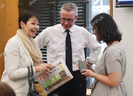 British Secretary of State for the Environment, Michael Gove (C) shares a joke with Green party Leader and Member of Parliament Caroline Lucas (L) during an event inside the Houses of Parliament in Westminster, London, Britain, 23 April 2019. Greta Thunberg, was joined by Green Leader Caroline Lucas, Former Labour leader, Ed Miliband and Secretary of State for the Environment, Michael Gove. Her visit coincides with the ongoing 'Extinction Rebellion' protests across London aimed to highlight the dangers of climate change.