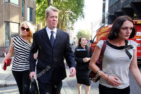Earl Spencer, his daughter Kitty, left, and Lady Bianca Eliot, right, leave his divorce hearing from Caroline Spencer in central London