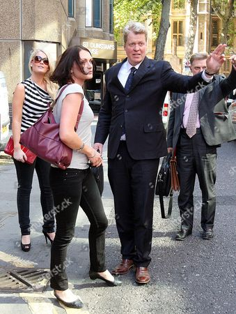 Earl Spencer, his daughter Kitty, left, and Lady Bianca Eliot leave his divorce hearing from Caroline Spencer in central London