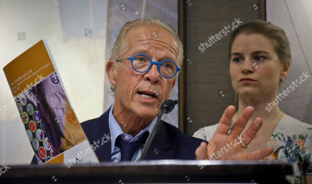 """Anderson, Farrell. Attorney Jeff Anderson, left, survivor and advocate Birdie Farrell, right, hold a press conference to release the names of more than 130 Boy Scout leaders who worked in New York and were named in Boy Scouts of America (BSA) """"Perversion Files"""" as having allegations of sexually abusing minors, in New York"""