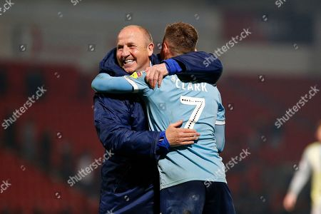 John Coleman Manager/Head Coach of Accrington Stanley embraces Jordan Clark of Accrington Stanley after the EFL Sky Bet League 1 match between Doncaster Rovers and Accrington Stanley at the Keepmoat Stadium, Doncaster