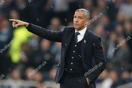 Brighton's team manager Chris Hughton gives directions to his team during the English Premier League soccer match between Tottenham Hotspur and Brighton & Hove Albion at Tottenham Hotspur stadium in London