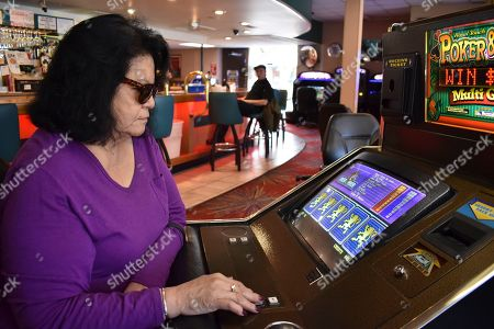 Lucille Brien plays a video poker machine at the Monte Bar and Casino in Billings, Montana, . Montana, Iowa and Indiana are poised to be the first states to legalize sports betting this year, almost a year after the U.S. Supreme Court ended Nevada's monopoly