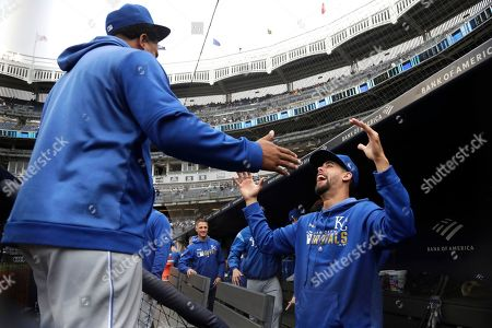 Kansas City Royals relief pitcher Wily Peralta, left, and relief pitcher Jorge Lopez react during the first inning of a baseball game against the New York Yankees, in New York