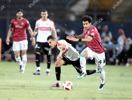 Stock Photo of Zamalek player Ibrahim Hassan (L) in action against Pyramids player Omar Gaber (R) during their Egyptian league football match between Zamalek and Pyramids in Cairo, Egypt, 23 April 2019.