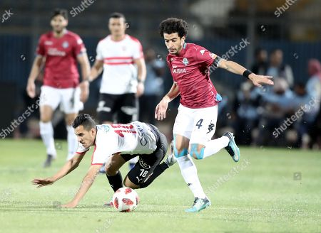 Stock Image of Zamalek player Ibrahim Hassan (L) in action against Pyramids player Omar Gaber (R) during their Egyptian league football match between Zamalek and Pyramids in Cairo, Egypt, 23 April 2019.