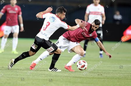 Zamalek player Tarek Hamid (L) in action against  Pyramids player Abdallah El Said (R) during their Egyptian league football match between Zamalek and Pyramids in Cairo, Egypt, 23 April 2019.