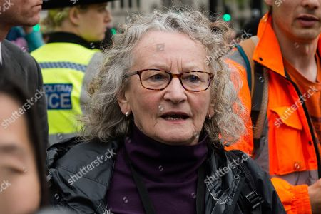 Baroness Jenny Jones outside House of Commons as Extinction Rebellion activists try to deliver letters to their MPs asking them to take action on climate and ecological crisis, on the ninth day of protest action in Parliament Square.
