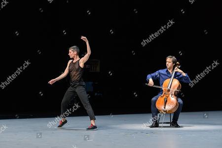 "Stock Photo of Anne Teresa De Keersmaeker, Jean-Guihen Queyras and Rosas present ""Mitten wir im Leben sind/ Bach6Cellosuiten"" at Sadler's Wells. Pictured: Marie Goudot (dancer) and Jean-Guihen Queyras (cellist)."