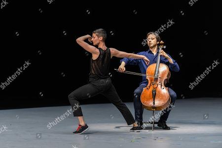 "Anne Teresa De Keersmaeker, Jean-Guihen Queyras and Rosas present ""Mitten wir im Leben sind/ Bach6Cellosuiten"" at Sadler's Wells. Pictured: Marie Goudot (dancer) and Jean-Guihen Queyras (cellist)."