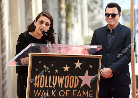 """Stock Picture of Seth MacFarlane, Mila Kunis. Actress Mila Kunis, left, speaks during a ceremony awarding Seth MacFarlane, right, with a star on the Hollywood Walk of Fame, in Los Angeles. Kunis starred with MacFarlane on his 2012 comedy film """"Ted"""" and voices the character Meg Griffin on his animated television series """"Family Guy"""