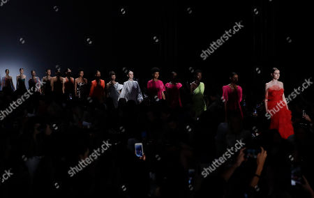 Models wear creations from the Fabiana Milazzo collection during Sao Paulo Fashion Week in Sao Paulo, Brazil
