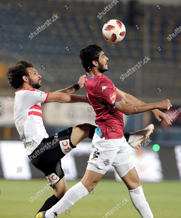 Pyramids Ali Gabr in action with Zamalek Mahmoud Alaa (L) during the Egyptian league football match between Zamalek and Pyramids in Cairo, Egypt, 23 April 2019.