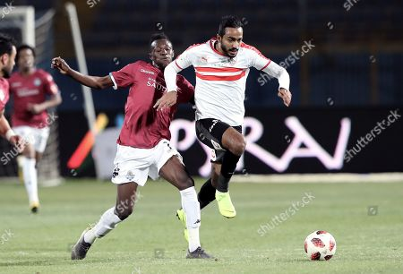 Zamalek's Kahraba in action with Pyramids Eric Traore (L) during the Egyptian league football match between Zamalek and Pyramids in Cairo, Egypt, 23 April 2019.