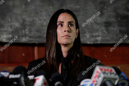 Former sports reporter Kelli Tennant attends a news conference, in Los Angeles. Tennant filed the suit in Los Angeles County Superior Court on Monday, contending new Sacramento Kings coach Luke Walton assaulted her in a hotel room in Santa Monica while he was an assistant coach for the Golden State Warriors