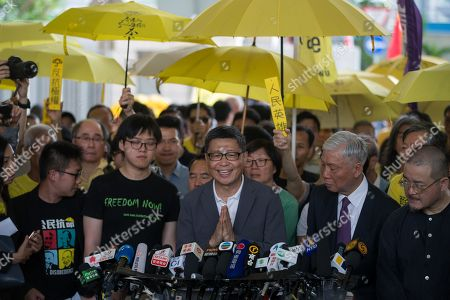 Occupy Central activists Raphael Wong (L, front), Tommy Cheung Sau-yin (2-R, front), Chan Kin-man (C, front), Reverend Chu Yiu-ming (2-R, front) and lawmaker Shiu Ka-chun (R, front) speak to the media before their sentencing, outside West Kowloon Magistrates Court in Hong Kong, China, 24 April 2019. Key leaders of the Occupy protest movement called on their supporters to continue their fight as most of the leaders hinted that they expect to be in prison for an extended period of time following the sentencing. The Umbrella movement, which occurred concurrently with Occupy Central, ran for 79 days in 2014.