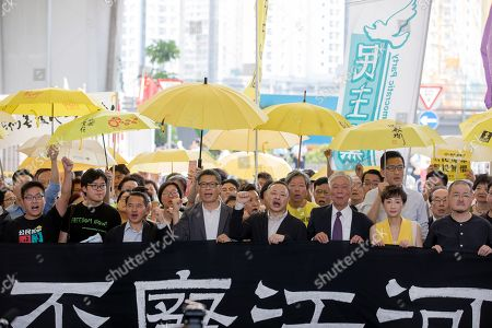 Occupy Central activists Raphael Wong (L), Tommy Cheung Sau-yin, (2-R), former Democratic Party lawmaker Lee Wing-tat (3-L), Chan Kin-man (4-L), Benny Tai (4-R), Reverend Chu Yiu-ming (3R), Civic Party lawmaker Tanya Chan (2-R) and lawmaker Shiu Ka-chun (R) chant slogans before their sentencing, outside West Kowloon Magistrates Court in Hong Kong, China, 24 April 2019. Key leaders of the Occupy protest movement called on their supporters to continue their fight as most of the leaders hinted that they expect to be in prison for an extended period of time following the sentencing. The Umbrella movement, which occurred concurrently with Occupy Central, ran for 79 days in 2014.