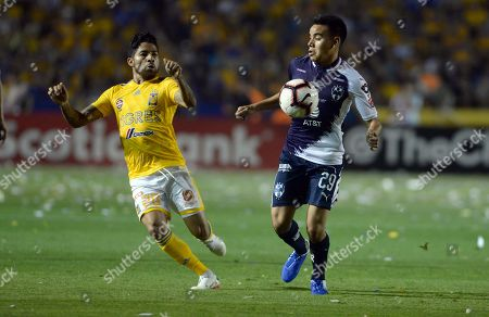 Javier Aquino (L) of Tigres UANL in action against Carlos Rodriguez (R) of Monterrey during a first leg CONCACAF Champions League soccer match between Tigres UANL and Monterrey, held at the University Stadium in Monterrey, Mexico, 23 April 2019.