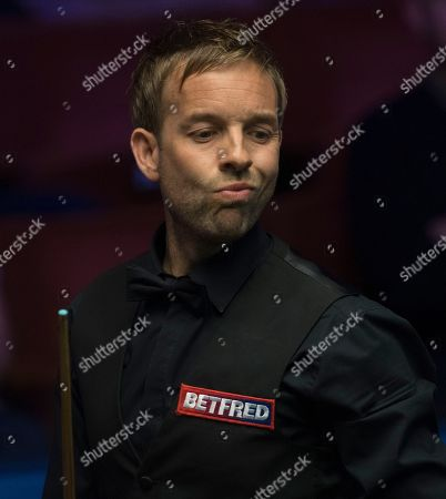 Ali Carter of England at the table during his first round match