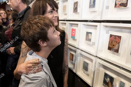 Asia Argento with son Nicola Giovanni at the opening of her photographic exhibition at the National Museum of Cinema