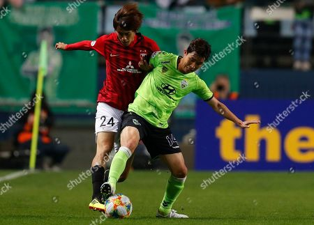 Koya Yuruki (L) of Urawa Red Diamonds in action against Lee Seung-gi (R) of Jeonbuk Hyundai Motors FC during the AFC Champions League group G soccer match between Urawa Red Diamonds and Jeonbuk Hyundai Motors FC at the Jeonju World Cup Stadium in Jeonju, South Korea, 24 April 2019.