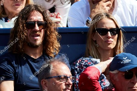 Stock Photo of Former FC Barcelona's soccer player Carles Puyol (L) and his wife Vanesa Lorenzo (R) attend the second round men's single match of the 67th Barcelona Open Trofeo Conde de Godo tennis tournament between Spanish Rafa Nadal and Argentine Leonardo Mayer, in Barcelona, Spain, 24 April 2019.