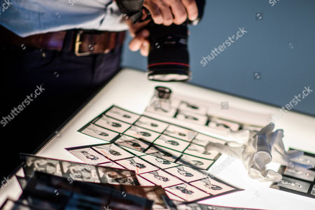 A press photographer takes pictures of a magnifier loupe on a light table and contact sheets on display during a press preview of the exhibition 'The Black Image Corporation' by Theaster Gates at the Martin Gropius Bau museum in Berlin, Germany, 24 April 2019. Concept artist Theaster Gates presents the work of photographers Moneta Sleet Jr. and Isaac Sutton and the Afroamerican culture magazines Ebony and Jet. The exhibition runs from 24 April to 28 July 2019 at the Martin Gropius Bau museum in Berlin.