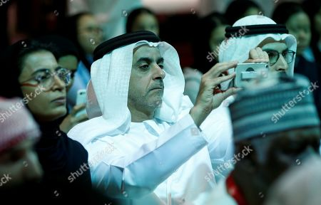 Lieutenant General Sheikh Saif Bin Zayed al-Nahyan (C), Deputy Prime Minister and Minister of Interior takes photo by his phone for former United States Secretary of State John Kerry during a session at the 2019 Abu Dhabi International Book Fair (ADIBF) in Abu Dhabi, International Book Fair (ADIBF) in Abu Dhabi,  United Arab Emirates, 24 April 2019. Former United States Secretary of State and author John Kerry is the Guest of Honor of the 2019 Abu Dhabi International Book Fair, which runs till 30 April 2019.