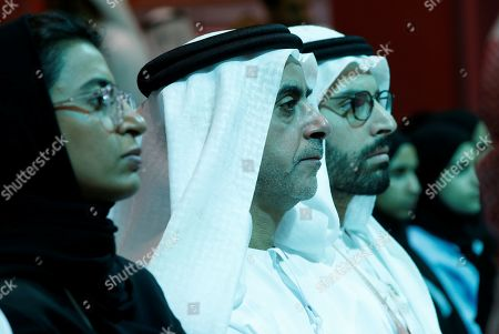 Stock Image of Lieutenant General Sheikh Saif Bin Zayed al-Nahyan (2-L), Deputy Prime Minister and Minister of Interior and Noura bint Mohammed Al Kaabi (L) , Minister of Culture and Knowledge Development listen to former United States Secretary of State John Kerry during a session at the 2019 Abu Dhabi International Book Fair (ADIBF) in Abu Dhabi,  United Arab Emirates, 24 April 2019. Former United States Secretary of State and author John Kerry is the Guest of Honor of the 2019 Abu Dhabi International Book Fair, which runs till 30 April 2019.