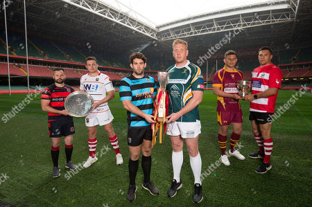 Left to right, Plate Finalists Andrew Pritchard, captain of Bonymaen, and Ewan Williams, captain of Brecon; Cup Finalists Joe Tomlinson, captain of Cardiff, and Craig Locke, captain of Merthyr; and Bowl Finalists Ieuan James, captain of Abergavenny and Keir Ennis, captain of Oakdale, during photocall with their respective trophies ahead of Finals Day