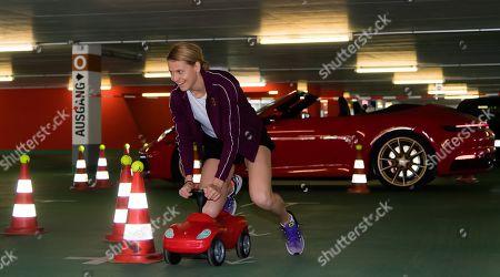 Lucie Safarova of the Czech Republic does the parking challenge at the 2019 Porsche Tennis Grand Prix WTA Premier tennis tournament