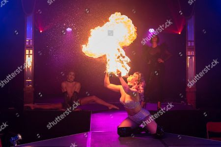 """Kitty Bang Bang (fire breathing bearded lady) performs at the preview of Bernie Dieter's """"Little Death Club"""" an eclectic performance show taking place at the Underbelly Festival on the Southbank until 23 June 2019."""