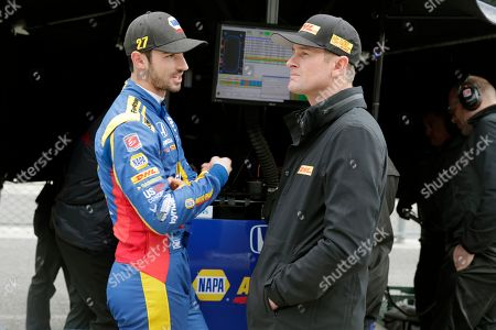 Ryan Hunter-Reay, Alexander Rossi. IndyCar drivers Alexander Rossi, left, and Ryan Hunter-Reay talks during a rain delay during auto racing testing at the Indianapolis Motor Speedway in Indianapolis