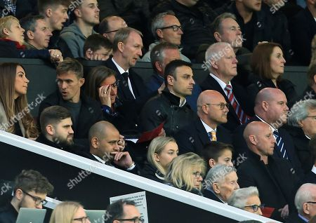 Stock Image of Dimitar Berbatov looks on from the stand