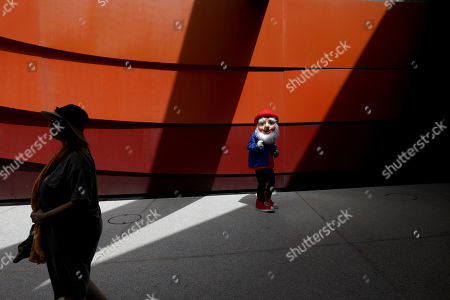 A man wears a gnome costume inside the Holon Design Museum, in the city of Holon, Israel, 24 April 2019. The museum designed by Israeli architect and industrial designer Ron Arad was first opened on 03 March 2010.