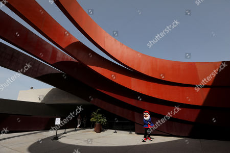 Stock Image of A man wears a gnome costume inside the Holon Design Museum, in the city of Holon, Israel, 24 April 2019. The museum designed by Israeli architect and industrial designer Ron Arad was first opened on 03 March 2010.