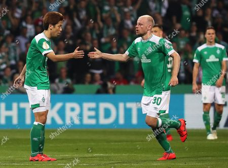 Bremen's Yuya Osako (L) celebrates with his teammate Davy Klaassen (R) after scoring their first goal during the German DFB Cup semi final soccer match between Werder Bremen and Bayern Munich in Bremen, Germany, 24 April 2019.