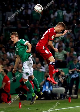 Bremen's Ludwig Augustinsson (L) in action against Bayern's Joshua Kimmich (R) during the German DFB Cup semi final soccer match between Werder Bremen and Bayern Munich in Bremen, Germany, 24 April 2019.