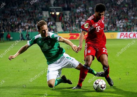 Bremen's Ludwig Augustinsson (L) in action against Bayern's Serge Gnabry (R) during the German DFB Cup semi final soccer match between Werder Bremen and Bayern Munich in Bremen, Germany, 24 April 2019.