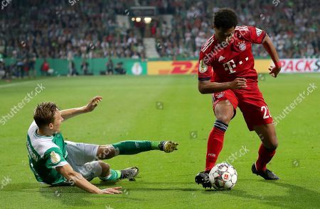 Stock Photo of Bremen's Ludwig Augustinsson (L) in action against Bayern's Serge Gnabry (R) during the German DFB Cup semi final soccer match between Werder Bremen and Bayern Munich in Bremen, Germany, 24 April 2019.