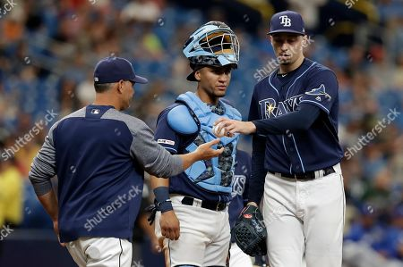 Kevin Cash, Blake Snell, Michael Perez. Tampa Bay Rays pitcher Blake Snell, right, hands the ball to manager Kevin Cash, left, as he is taken out of the game against the Kansas City Royals during the fourth inning of a baseball game, in St. Petersburg, Fla. Looking on is Rays catcher Michael Perez