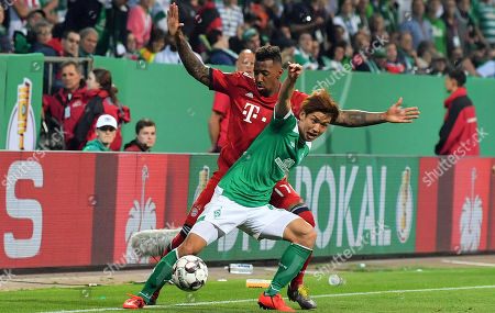 Bayern's Jerome Boateng (back) in action against Bremen's Yuya Osako (front) during the German DFB Cup semi final soccer match between Werder Bremen and FC Bayern Munich in Bremen, Germany, 24 April 2019.